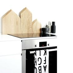 ferm LIVING Cutting Boards inspired by roof tops in Copenhagen seen from above.  see more here: http://www.fermliving.com/webshop/shop.aspx?eComSearch=True&ID=14&eComQuery=Cutting+Board+-