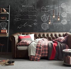 Red + Gray tartan bedding, leather Chesterfield daybed.