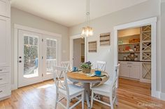 A charming eat-in kitchen area with a huge walk-in pantry! Types Of Cabinets, Wood Cabinets, Kitchen Cabinets, Discount Cabinets, Kitchen Cabinet Accessories, Pantry Makeover, Bespoke Kitchens, Eat In Kitchen, Cooking