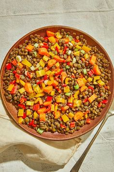 This quick and easy 20-minute lentil salad recipe incorporates brown lentils, celery, carrots, bell pepper, scallions, lemon, white wine vinegar and honey to create the ultimate healthy salad recipe. Whether you're eating this lentil recipe for an appetizer, light lunch or side dish, it's a great choice for a healthy recipe. #saladrecipes #lentilsalads #weeknightdinners #lentilrecipes #healthysalads #healthyrecipes