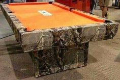 Camo pool table!!! I know what get my boyfriend for Christmas lol