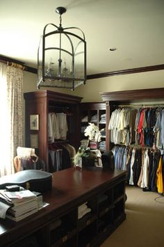 This closet was designed to look like a Ralph Lauren store. Design by Cindy Rinfret, photography by Stacy Kunstel