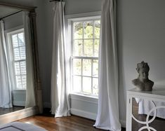 grey walls, white furniture, large mirror, white linen curtains. perfection.