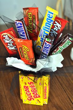 candy bouquet. cute! But it tells you to hot glue sticks to the chocolate bars. wouldn't they melt??? Think I'll try glue dots.  Might be good for Sunday School teacher asst gifts.