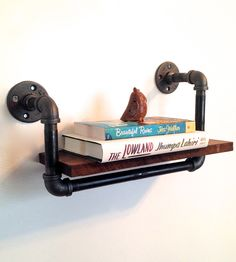 Reclaimed Wood & Pipe Book Shelf by Arc + Timber.
