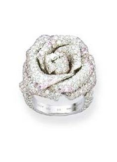 A DIAMOND ROSE RING, BY CHRISTIAN DIOR  The pavé-set diamond rose with pink diamond detail to the pavé-set diamond hoop, mounted in 18k white gold, ring size 6¾, with French assay mark for gold Signed Christian Dior, no. A2511