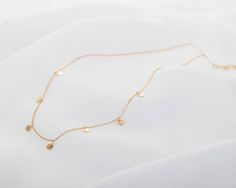 This delicate and affordable Necklace is perfect for gift for your girlfriend, bridesmaids, best friend, mum, baby and your loved one in any occasions! .... Tiny Disc Chain Choker …. MATERIAL: Top 100% high quality. All the components of the bracelet is rhodium plated, 14k gold plated or 14k rose gold plated, including the chain and other components. .... SIZING: The size of disc is 4mm(total 7 charms on the choker.) Chain length is 14 and is adjustable to 15.5. Please note that the chain…