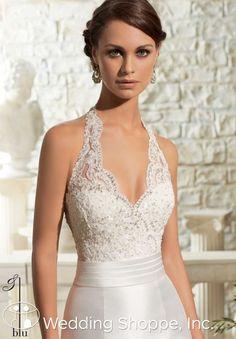 Elegant lace and satin halter wedding dress.