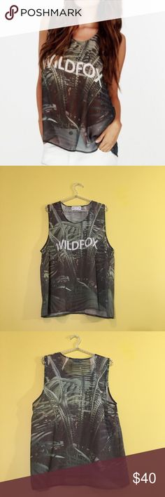 "WILDFOX Jungle Tank Great overall condition! The size tag was cut off but it's a size L and oversized! Sheer with little to no stretch. Measurements: 22"" bust (armpit to armpit), 27"" length. No trades, reasonable offers please! Wildfox Tops Tank Tops"