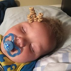 Latest Internet Trend: Dads Stacking Cereal On Their Sleeping Babies