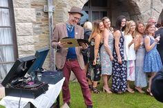 Mike selects another record whilst guests pose for pictures.  #cornwallwedding #cornwallweddingdj #gramophone #78records #vintagedj #weddingmusic #entertainment #records #vintage #retro #cornwall #weddding #dj