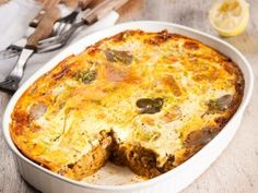 Here's an affordable and tasty alternative to beef or lamb bobotie: fish bobotie using canned pilchards and lentils. Fish Dishes, Seafood Dishes, Seafood Recipes, Tuna Dishes, Savory Snacks, Snack Recipes, Cooking Recipes, Tuna Recipes, Inexpensive Meals