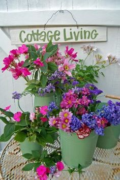 green tin cans with pink and purple flowers