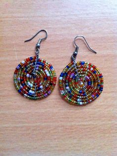 Colorful beaded swirl earrings. 100% of sales go to support the Youth Education Network of Kenya - www.yenkenya.org