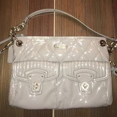 Silver Coach crossbody Silver Coach clutch and also crossbody purse. Couple small scuffs on the front but very minor! Coach Bags Clutches & Wristlets