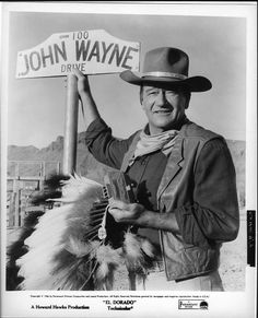"EL DORADO (1967) - John Wayne was honored with the dedication of ""100 John Wayne Drive"" sign on the Old Tucson movie set - Directed by Howard Hawks - Paramount."