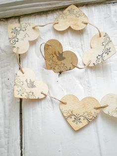 Remember that hearts are Christmas symbols too. The heart garland looks awesome a tree, especially Victorian motif or rustic chic, or childrens. The hearts can be made out of all sorts of things from Burlap to expensive papers. or even thin flashing type sheet metal. paper heart garland...lovely for anytime of years in my book. Cheers.
