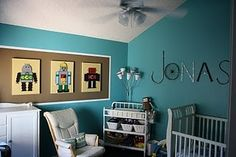 Robot kids room-a calling same color walls as our office in the big house looks easy n has Jonas on the wall. Is this a Ka-winky-dinky?