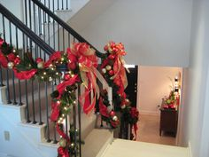 Stairwell garland and bows holiday design by Nature of Design with Janet Flowers