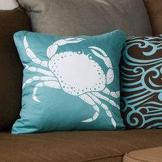 This feisty Crab throw pillow in organic cotton provides breezy beach house style.