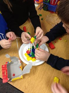 """Building Structures: Read the Three Little Pigs and discuss building materials. Then, students have to create structures that will withstand the """"big bad wolf"""" (a hairdryer with a wolf face on it!)"""