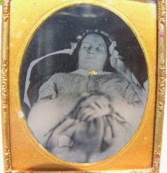 Framed woman in headdress, post mortem