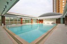 Solarkent Situated in Istanbul this large retracting roof covers a residential shared pool. This motorized 18m wide by 22m long retractable roofing was built for a pool building connected to a large apartment complex