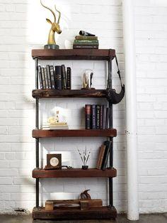 diy industrial rustic bookshelf: combine reclaimed wood and galvanized black pipe.