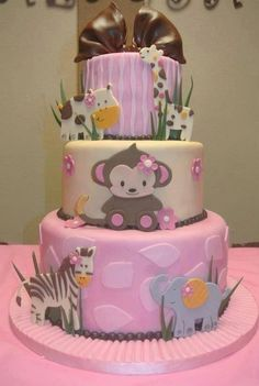 Cute baby girl safari theme cake. Looks good for baby shower & birthday party. :)