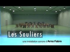 Sound installation from Arno Fabre - 2009.  LES SOULIERS (THE SHOES) is an ensemble of thirty pairs of shoes mechanically queued by tramplers and computer-controls. These shoes hit and rub the floor to make acoustic music according to an original composition developed by a numerical Midi score (run by max/msp software). The selection of shoes, the composition they perform, and the scenography make a singular work between contemporary art and puppetry, contemporary music and electronic…