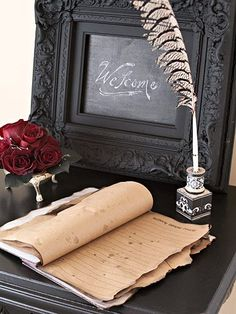arrival - have guests sign old fashioned guest book with quill and ink