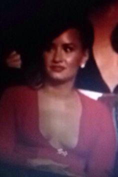 Demi during 5sos' performance.... << IS THIS REAL IM LAUGHING<<<<she just jelous bc they won best lyric video and not her haha loser!!!!!!!
