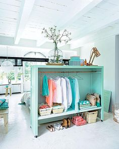 4 Space-Making Room Dividers That Double As Storage: Room Divider Doubles as a Bedroom Closet