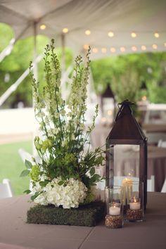 Amazing unique centerpiece! // floral design by http://www.myrtieblue.com, photo by Meg Baisden Photography
