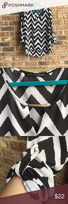 ⚡️LABOR DAY FLASH SALE⚡️Black & White Chevron top This black and white chevron top is super light and has the high-low feature. My favorite part of this top is the keyhole at the neck (seen in second picture). The sleeves roll and gather at the elbows (seen in the third picture). Super cute top that is perfect for a night out or to wear to the office! 💖Don't forget to Bundle & Save💖 Zac & Rachel Tops Blouses