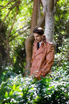 Exclusive vintage menswear only at C. Madeleine's. Shop online at www.cmadeleines.com - Camel Leather Men's Double Breasted Trench Coat. Shot by Agata Rek Directed by Gabriela David