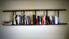 Ladder bookshelf. Thinking of doing this im our new living room.