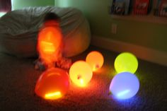 Glow sticks inside balloons. Great for a camp site.