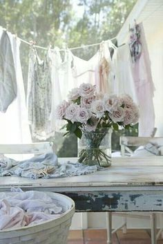 I can smell the clean laundry from here. Clothes line pink flowers shabby table