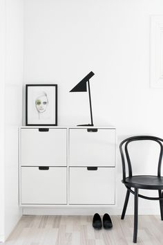 "Lovely black 'n white scene. Cool DIY idea: that Arne Jacobsen ""lamp"" was made using washi tape :-)."