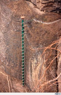 Spiral Staircase - Located in the Taihang Mountains, these stairs are 300ft tall and allow a bird's eye view of Linzhou. However beware-- you must be under 60 to climb this attraction! A world of no!