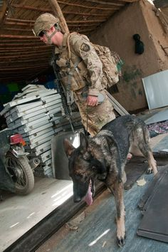 Staff Sgt. J.D. Wake and his working dog Csuma, search a metal workshop for contraband during a joint operation with the Afghan Uniformed Police and 503rd Military Police Battalion, 2nd Stryker Brigade Combat Team, 2nd Infantry Division, in Afghanistan.