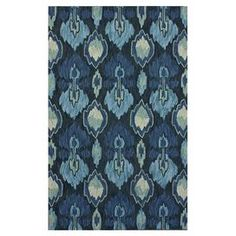 Hand-tufted rug with an ikat motif.   Product: Rug  Construction Material: 100% Polyester    Color: Forest green   Features: Handmade   Tufted      Note: Please be aware that actual colors may vary from those shown on your screen. Accent rugs may also not show the entire pattern that the corresponding area rugs have.  Cleaning and Care: These rugs can be spot treated with a mild detergent and water. Shake rug from time to time to restore its natural beauty.