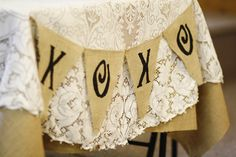 My wedding. banner hung from the bride and groom's table which was covered in burlap and lace. my great-great- grandmothers lace tablecloth. love.