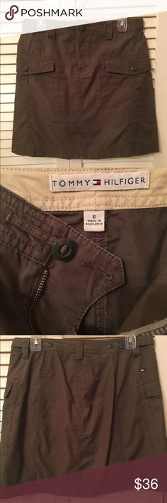 """⬇️💲NWOT - Tommy Hilfiger Khaki/Olive Skirt NWOT - Tommy Hilfiger khaki/olive skirt with front button down pockets.  Belt loops with tabs to adjust waist by moving the button in. Front zip and button closure. Skirt measures 19"""" from waist to hem. Back has no buttons or pockets.  Smoke free home. Reasonable offers (especially bundles😃!) considered through the offer button. Thanks! Tommy Hilfiger Skirts"""