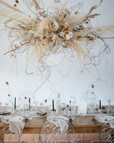 The latest wedding trend is nebulous, airy and levitational designs and we are OBSESSED! Dried branches and florals, kokedama botanical inspo and frozen in time design inspiration were loving right now! #weddingtrends #weddinginstallations #airyweddingd