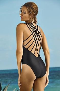 New PilyQ 2015 Resort Collection! This sophisticated and sexy black one piece swimsuit has amazing detail on the back with a V-neckline plunge, removeable pads, fully lined. It provides Moderate-Full rear coverage. Made in Columbia. FINAL SALE ITEM!
