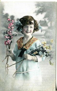 http://www.ebay.com/itm/1913-GERMANY-POSTCARD-VINTAGE-Real-photo-A-GIR-WITH-FLOWERS-/282012855366