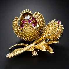 Tiffany & Co; Elegant and elaborate mid-century floral brooch made and signed by Tiffany & Co.the four petals of the larger blossom opens and closes - depending on the time of day of course. 18 Karat yellow gold.
