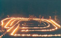 Labyrinth of ire. A beach labyrinth being lit. I've never seen such a thing- dramatic!